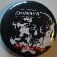 Oxymoron – Crisis (Badges)